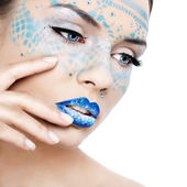 A beautiful woman with a fantastic makeup — Stock Photo
