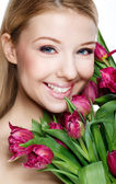 Beautiful blonde with flowers — Stock Photo
