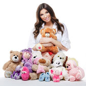 Beautiful happy pregnant woman with plush toys — Stock Photo