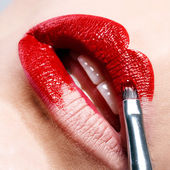 Beautiful shiny red lips — Stock Photo