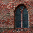Gothic brick wall with a window,a stained glass window — Stock Photo #22594277