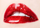 Beautiful female with red shiny lips closeup — Foto Stock