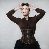 Beautiful fashionable woman in the style of steampunk — Stock Photo