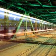 Tram in traffic on the bridge at night - Stock Photo