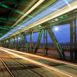 Tram in traffic on bridge at night — Stock Photo #24542227