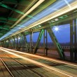 Tram in traffic on the bridge at night — Stock Photo