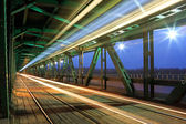 Tram in traffic on the bridge at night — Stock Photo
