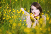 Beautiful woman in flowery meadow — Stock Photo
