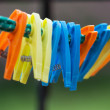 Colorful clothes pegs — Stock Photo #28325141