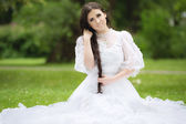 Beautiful woman in a gothic wedding dress — Stock Photo
