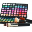 Eye shadows and makeup brushes — Stock Photo