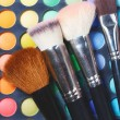 Eye shadows and makeup brushes — Stock Photo #30967907