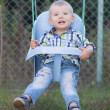 The little boy on a swing — Stock Photo