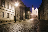 The street of the old town in Warsaw at night — Stock Photo