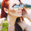 Beautiful red-haired woman in sunglasses  — Stock Photo