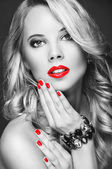 Portrait of a beautiful woman with red lips — Stock Photo
