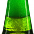 Green bottle of beer and gas bubbles — Stock Photo