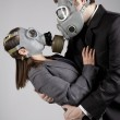 Couple in love in gas masks — Stock Photo #36789455