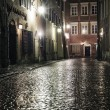 A street in the old town of Warsaw at night — Stock Photo