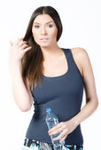 Beautiful woman with bottle of mineral water — Stock Photo