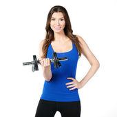 Female exerciser dumbbells — Stock Photo