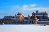 Teutonic Castle in Malbork winter. — Stock Photo