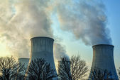 The smoke from the chimneys of a power plant — Stock Photo