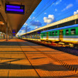 Train traffic on the railway station — Stock Photo