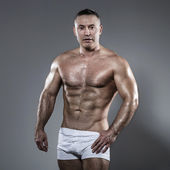 Bodybuilder in studio — Stock Photo