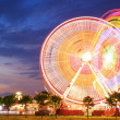 Amusement park at dusk - Ferris wheel in motion — Stock Photo #47420667