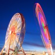 Amusement park at dusk - Ferris wheel in motion — Stock Photo #47420795