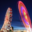 Amusement park at night - ferris wheel in motion — Stock Photo #47420823