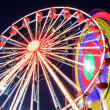 Amusement park at dusk - Ferris wheel in motion — Stock Photo #47635437