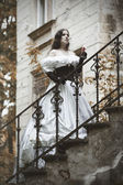 Mysterious woman in Victorian dress. Stylized photo at old — Fotografia Stock