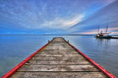 Wooden haven in the bay of Puck and boat — Stock Photo