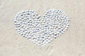 Heart of shells on the beach — Stock Photo