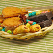Candy and cookies in a basket - Stock Photo