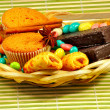 Candy and cookies in a  basket — Stok fotoğraf