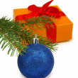 Gift box, fir branches and Christmas blue ball on white background — Stock Photo