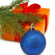 Gift box, fir branches and Christmas blue ball  on white background — Stock Photo #50145257