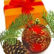 Isolated image of gift box, cones, fir branches and Christmas red ball on white background — Stock Photo #50145319