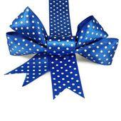 Beautiful holiday blue bow and ribbon on white background — Stock Photo
