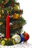 Burning candle near a Christmas tree — Stock Photo