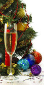 Festive image of a glass of champagne, candles and Christmas tree on a white background — Stock Photo