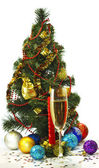 Beautiful festive image of a glass of champagne, candles and Christmas tree on a white background — Stock Photo