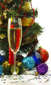 Isolated image of a glass of champagne, candles and Christmas tree — Stock Photo