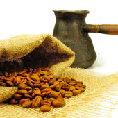 Isolated image of coffee pot and coffee beans closeup — Stock Photo