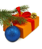 Isolated image of gift box, fir branches and blue Christmas ball — Stock Photo