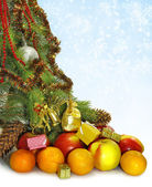 Christmas tree decorated with Christmas toys and different fruits — Stock Photo