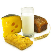 image of a glass of milk, cheese, bread and wheat on white background — Stock Photo